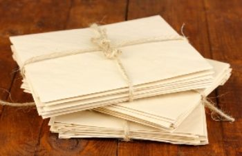 Stacks of old letters on wooden table