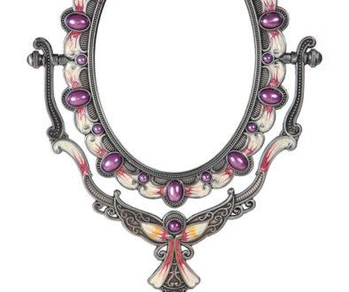 Metallic mirror on a stand on a white background, souvenir